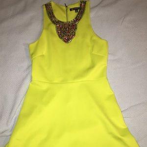 Scuba dress with beaded neckline